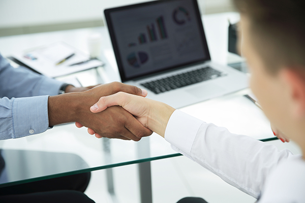 closeup.strong financial partners shaking hands over a Desk.the concept of partnership